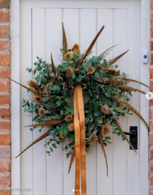 A fabulously feathery fresh evergreen Christmas wreath by Fierceblooms, Cheshire