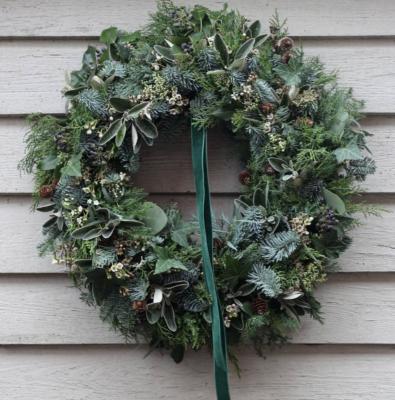 Understated elegance by The Garden Gate Southwold. Fresh evergreen wreath with green velvet ribbon.