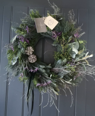 A fresh evergreen Christmas wreath with spruce, cones and wisps of dried flowers by Isla and Me, Lancashire