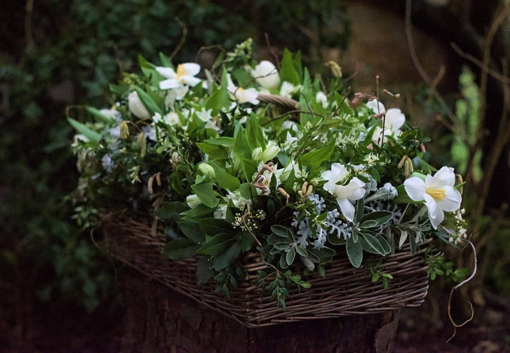 A winter basket of flowers for a funeral by Ivydene Flowers
