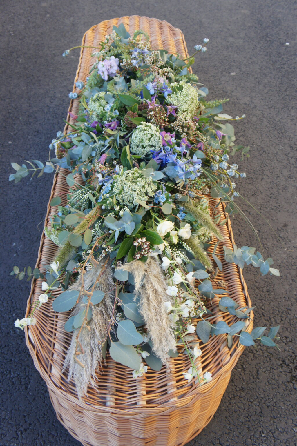 A tied sheaf with pampas grasses and eucalyptus by Briar Rose.
