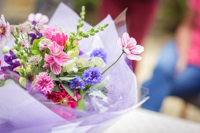 Cotswold Country Cut Flowers hand tied bouquet of summer flowers wrapped in tissue for a beautiful gift bouquet