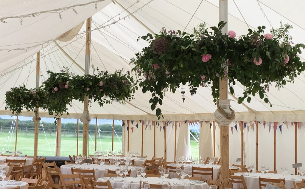 Foliage hoops for a marquee wedding by Field House Flowers.