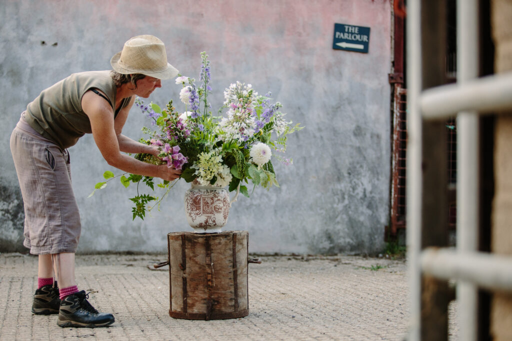 Rachel of Green and Gorgeous arranges freshly cut British flowers in a large ceramic urn.