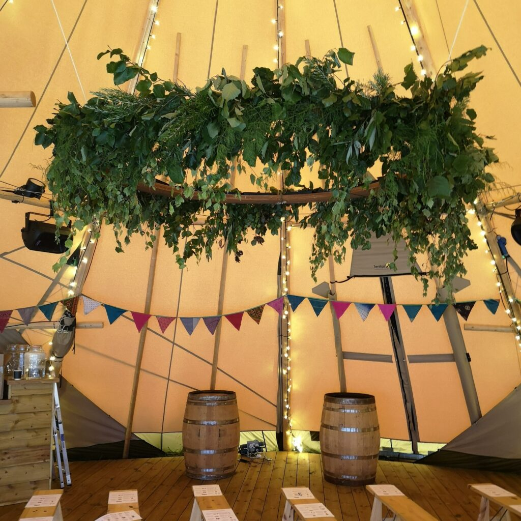 A spectacular foliage hoop for a tipi festival wedding by Greenery Flowers