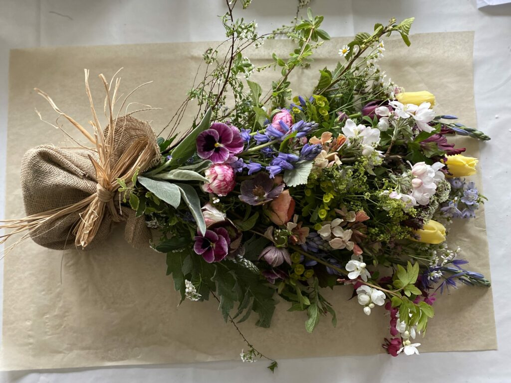 A natural spring funeral sheaf with British cut flowers by Henthorn Farm Flowers