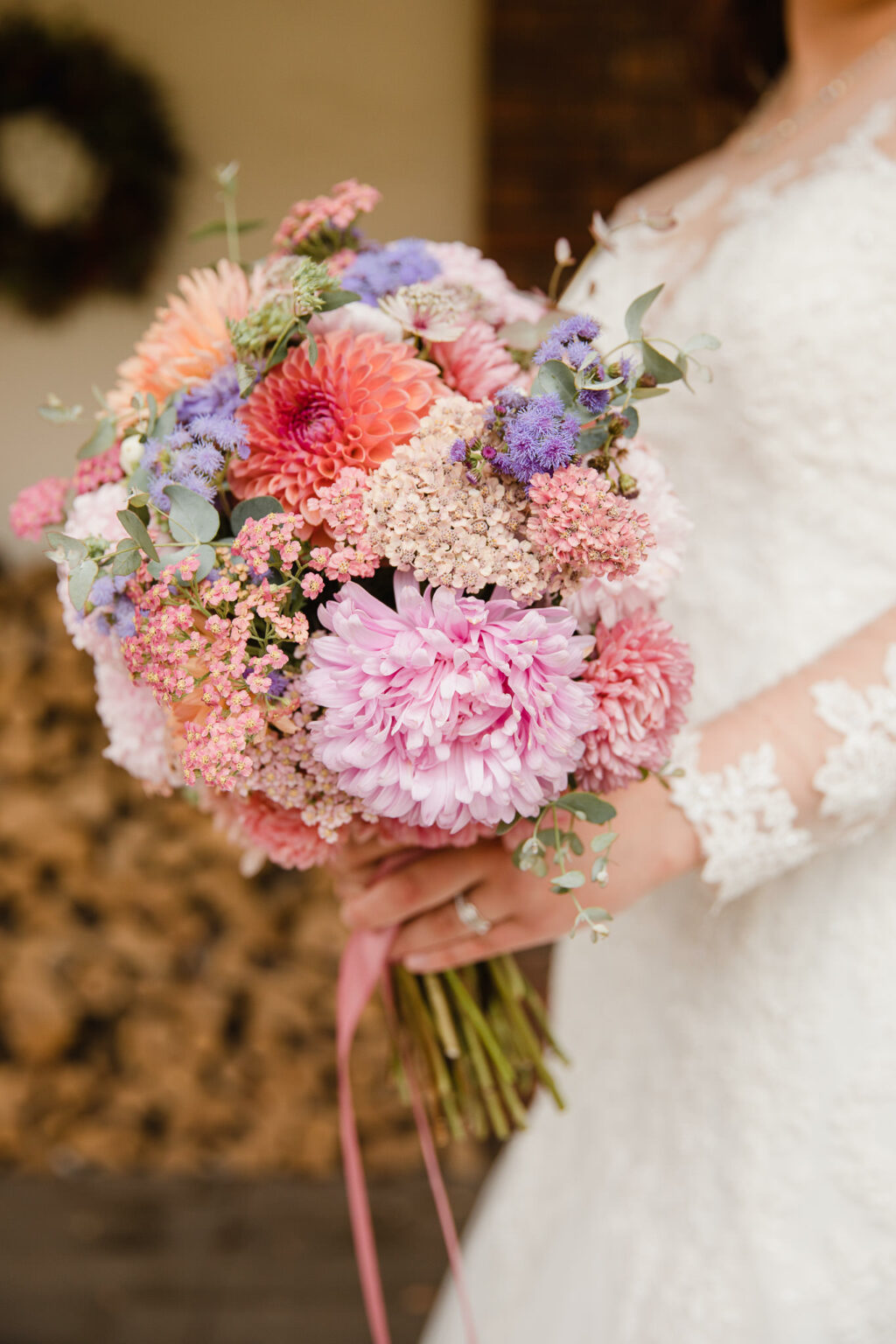A pastel textured wedding bouquet with dahlias and pale pink chyrsanths by Nature's Posy. Photo credit: Michelle Hugglestone
