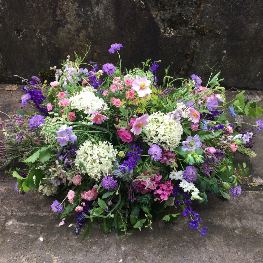 A wildflower style summer funeral tribute by Picking Posies