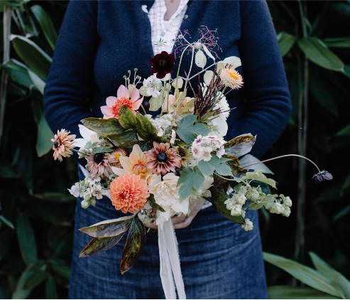 Queenie's Floral Design wedding bouquet for an autumn bride with dahlias and rudbeckias tied with silk ribbon