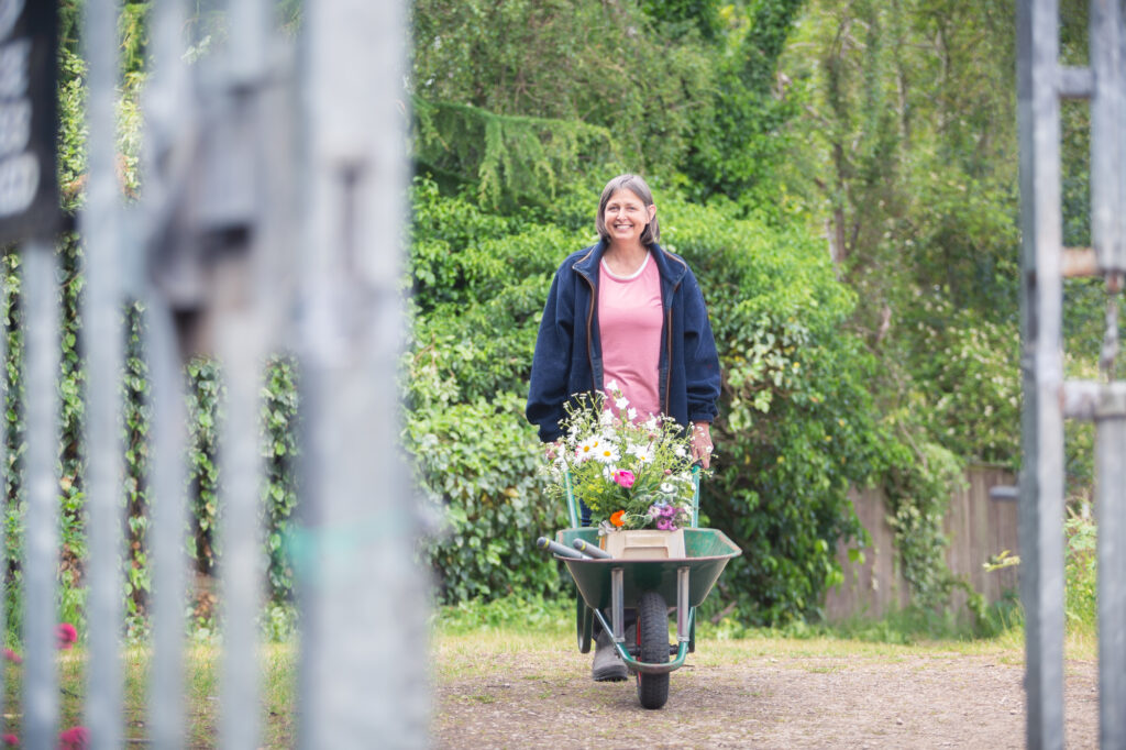 Famous locally as 'the wheelbarrow lady' Carole pushes her flowers back from her allotment regularly