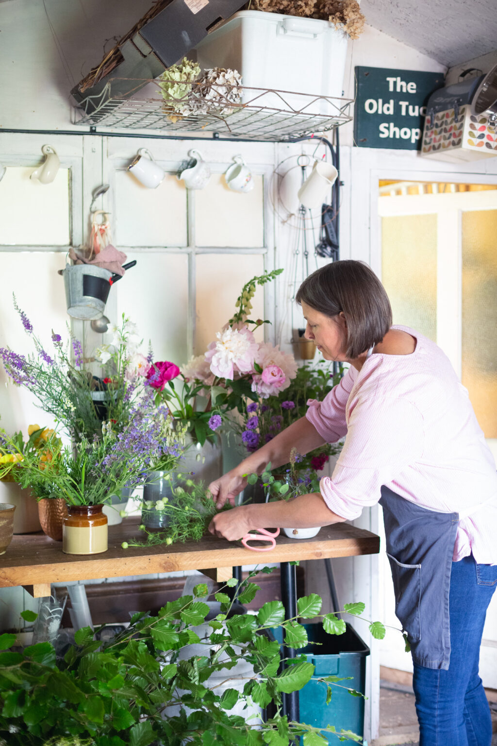 Carole of Tuckshop Flowers works from home in her garden workshop, making flowers for events, weddings and funerals.