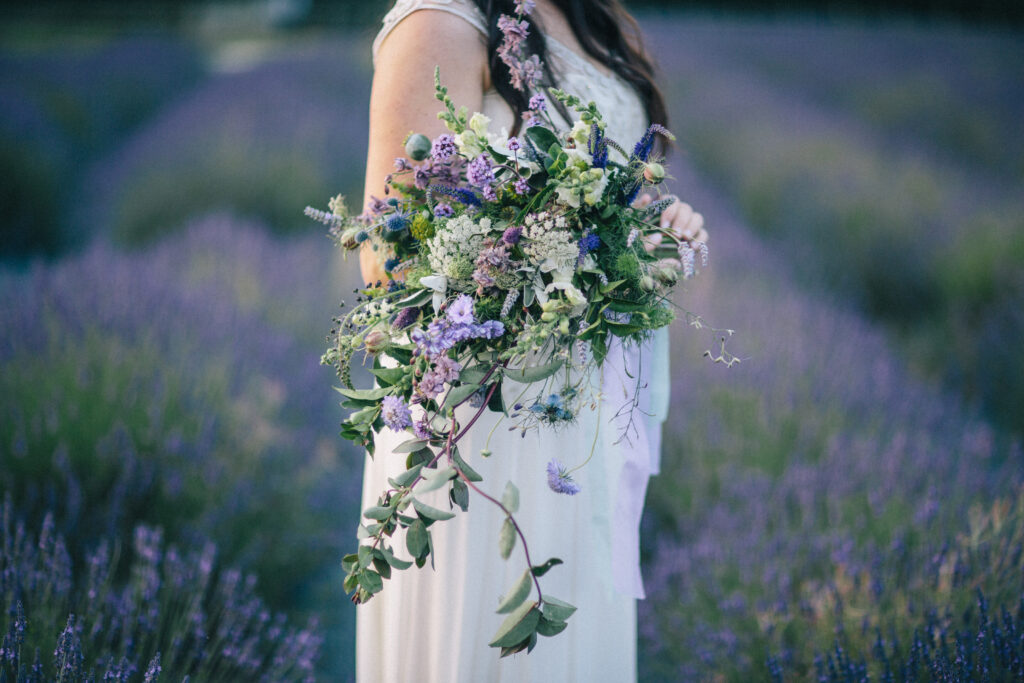 A wild cascading wedding bouquet with early summer British flowers by The Flower Farm