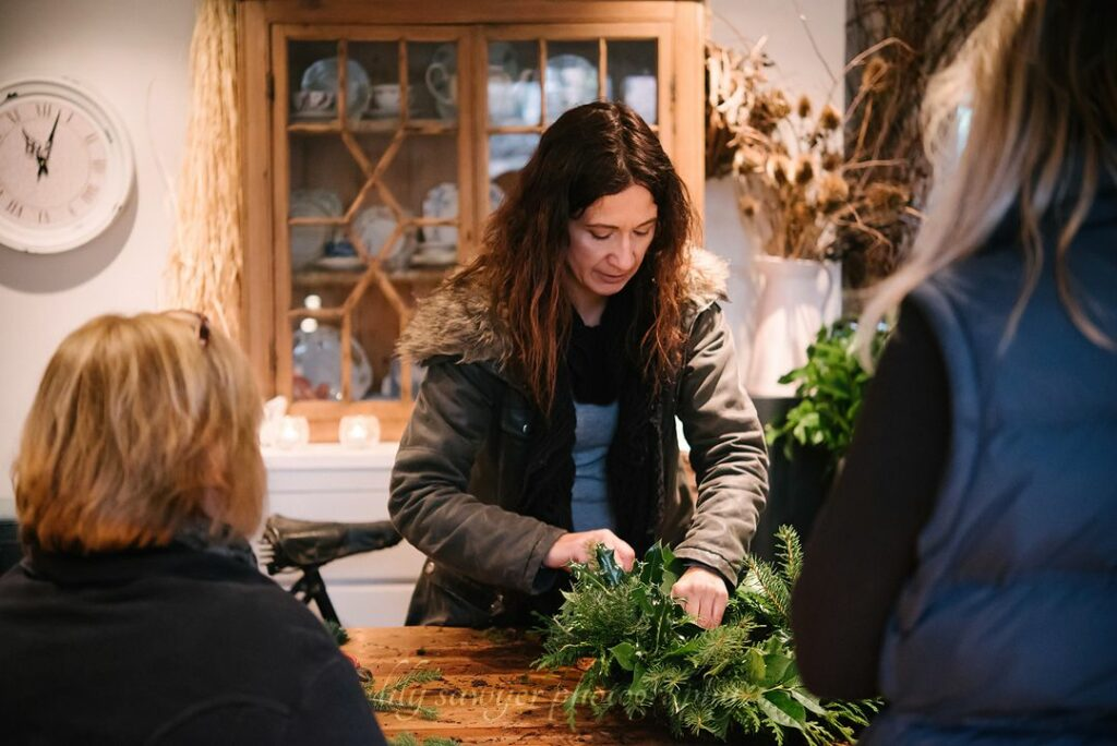 Emma of Urban Flowers teaches a workshop about making Christmas wreaths with seasonal British grown foliage.