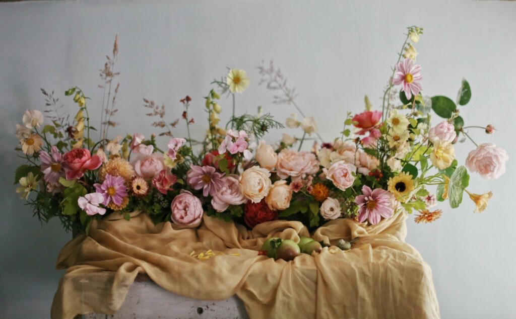 Wildbunch arranges abundant garden roses in a generously scented long low style arrangement for a wedding table