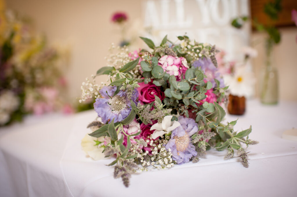 Woodchurch Cottage Flowers adds mint to a pastel early summer bride's bouquet with blue scabious and pinks