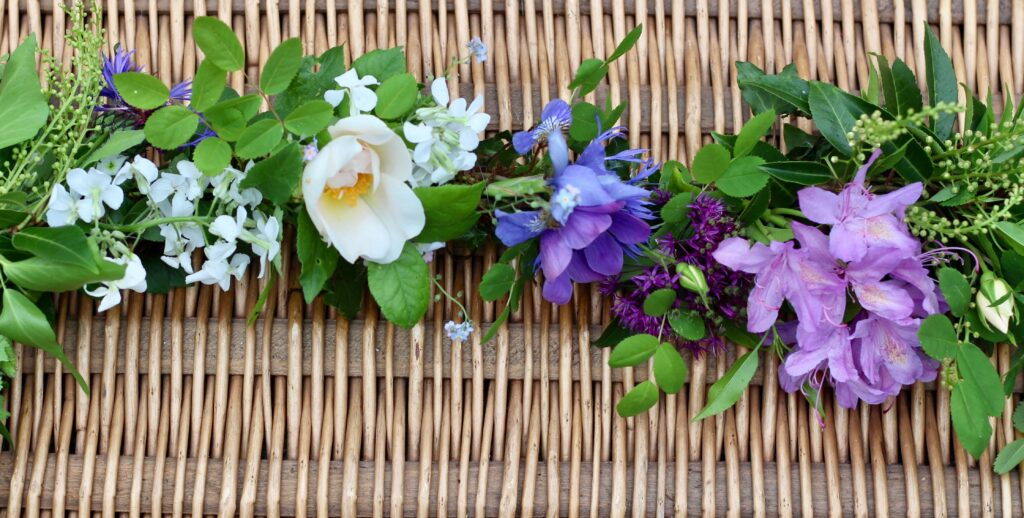 A June garland with roses, rhodedendrons and anemones. Tuckshop Flower