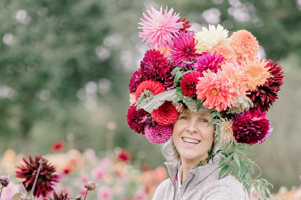 Philippa of Justdahlias in an amazing head dress of dahlias piled high by Kieran Bellis Photography.