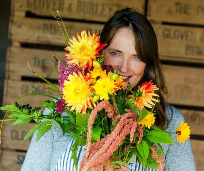 Kate Hurst of Camomile and Cornflowers holds a bright bunch of dahlias.