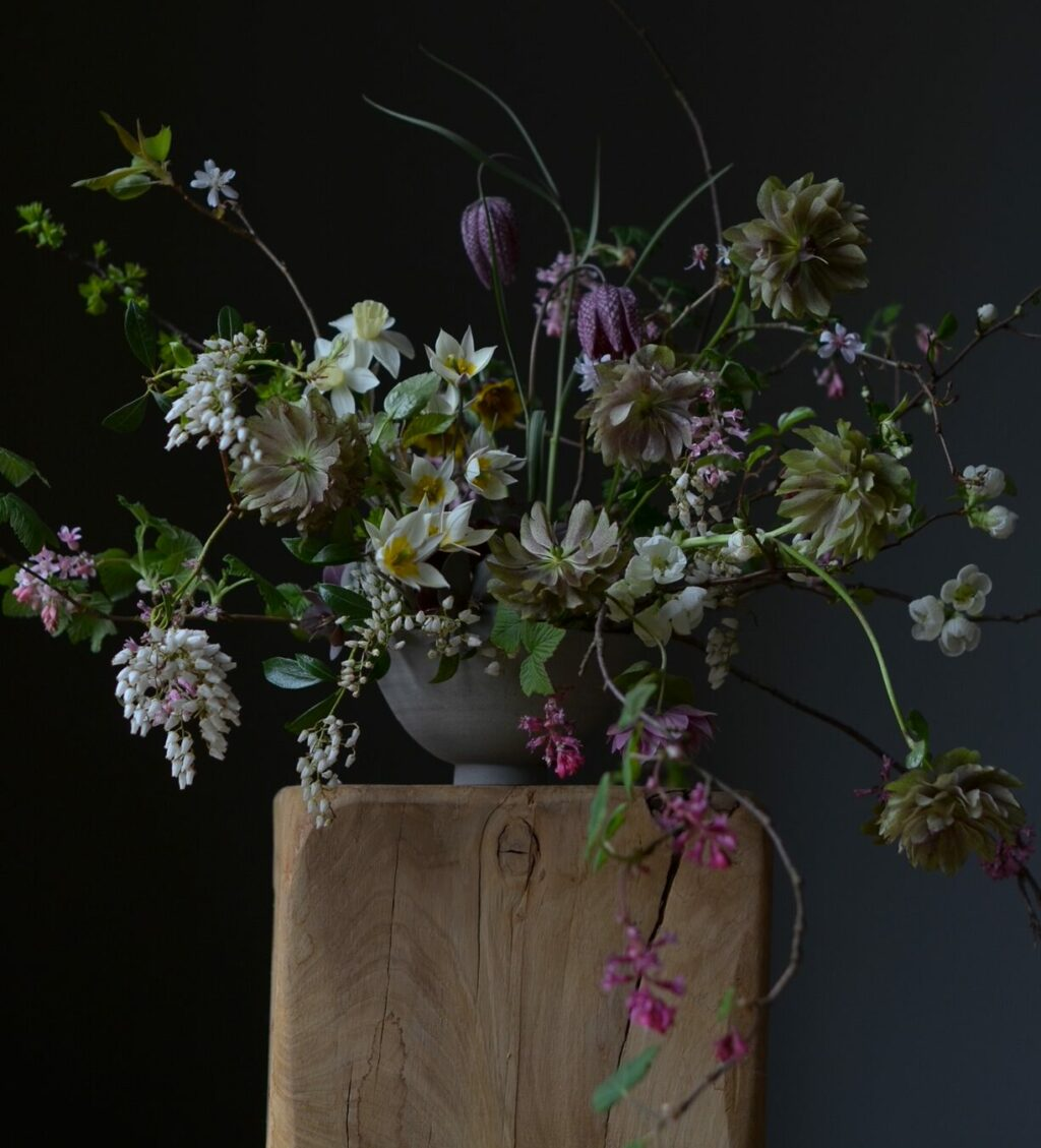 Simply by Arrangement's signature log pedestal and moody photography has grown her instagram following to huge numbers