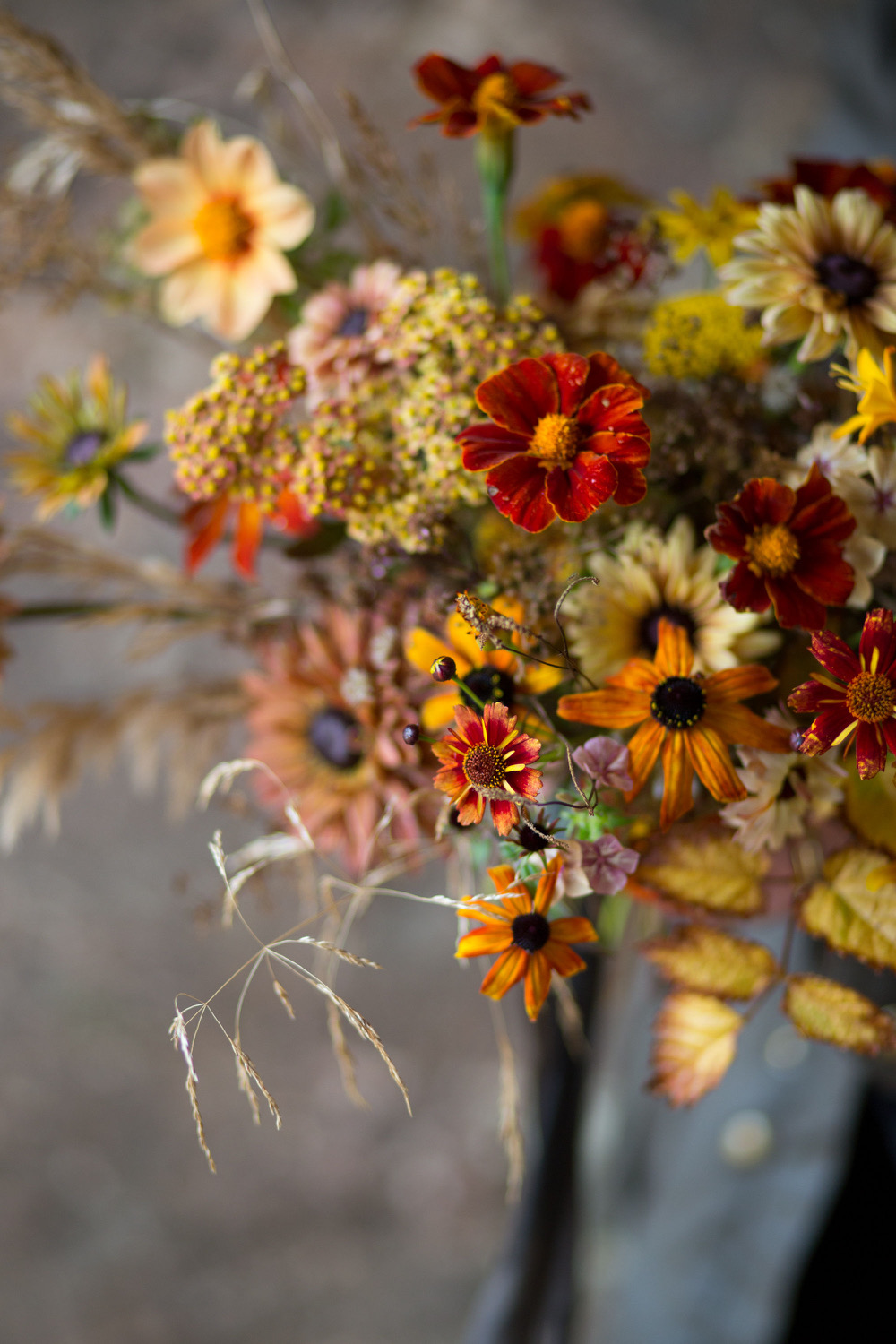 An autumnal arrangement with rudbeckias by Simply By Arrangement