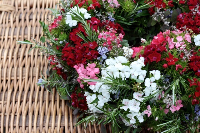 A funeral wreath with rosemary and sweet Williams by Tuckshop Flowers
