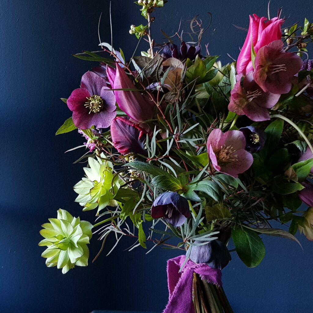 Northumbrian Flowers spring bouquet with deep purple and green hellebores.
