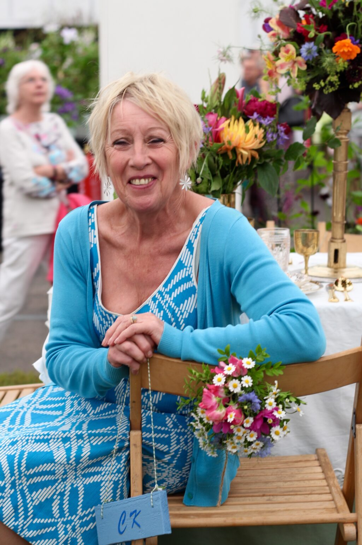 Carol Klein sits in her birthday chair at BBC Gardeners'World Live