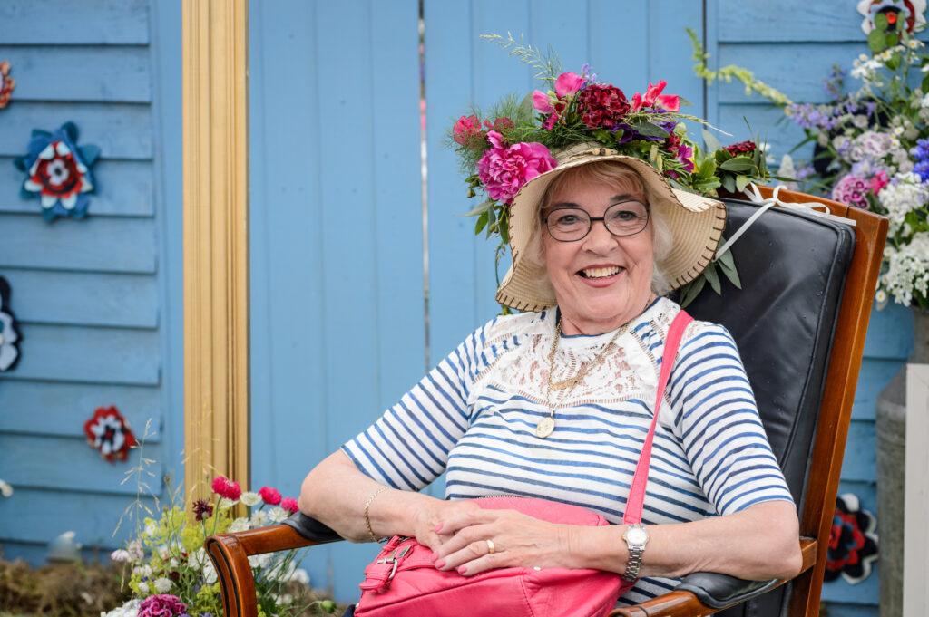 Visitors enjoying the flowery headgear for selfies at BBC Gardeners World Live. Photo: Jason Ingram