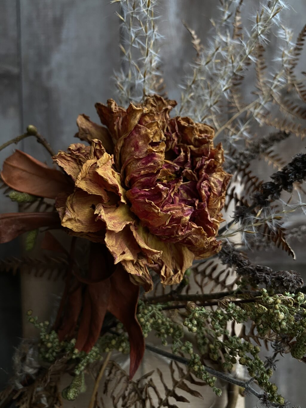 Dried dahlias mix well with other ingredients for winter arrangments.