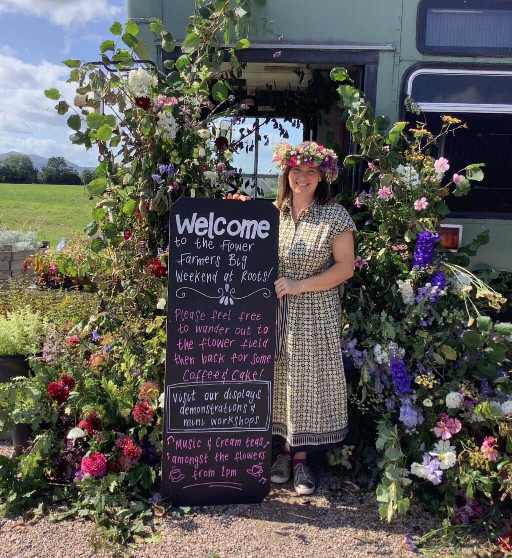 the first Flower Farmers Big Weekend 2019 Meg Edmonds welcomes visitors in the West Midlands region standing amongst the floral decorations