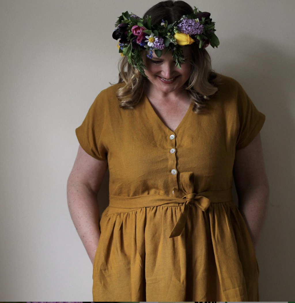Lauren of the Fox and Dingo models a spring flower crown to complement the rich ochre of her dress