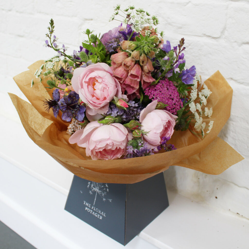 The Floral Potager presents a beautifully wrapped bouquet of soft scented pink garden roses and early summer ingredients from her cutting garden.