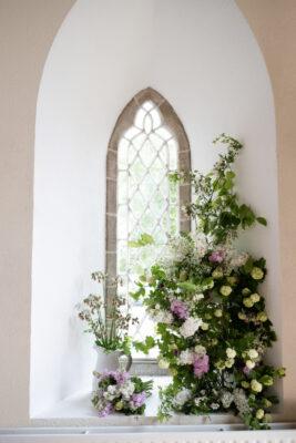 Beechfield Flowers Farm created this beautiful pastel toned, perfumed display of seasonal, local British flowers to climb alongside a gothic church window.
