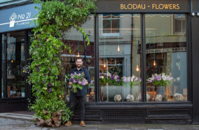 Alex of Number21 Flowers decorates his shop window with British flowers in celebration of British Flowers Week 2021. Photo: Naomi Campbell Photography
