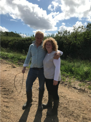 Carolyn Deeley of Pembridge Farm stands on her British cut flower farm with her partner.