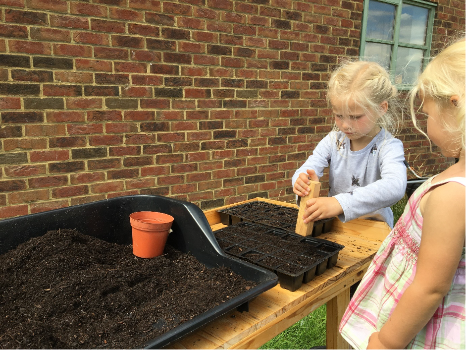 Starting them young! Carolyn's children help with sowing seeds for British cut flowers at Pembridge Farm