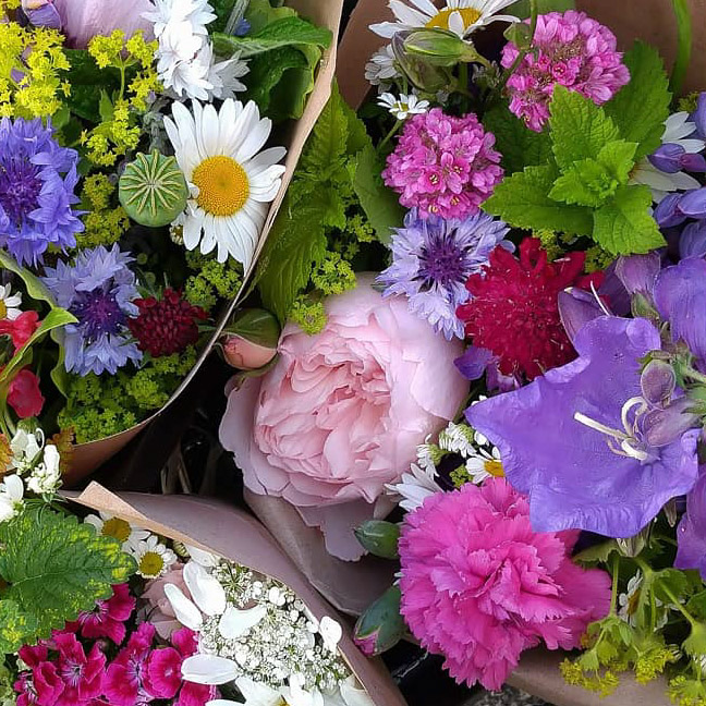 Bouquets of freshly picked locally grown flowers await delivery