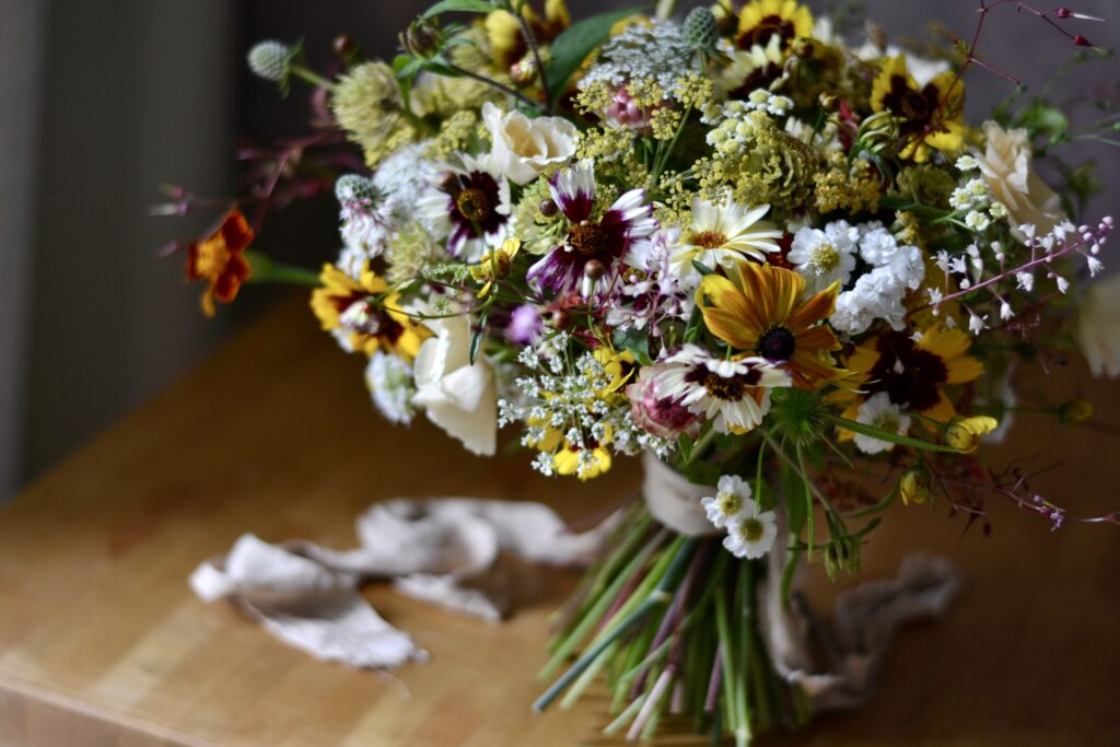 A summer bouquet of yellow and deep red flowers