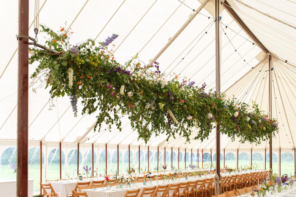 A huge suspended floral garland by Moat Farm Flowers showcases the impact of working with British flowers and foliage on a large scale