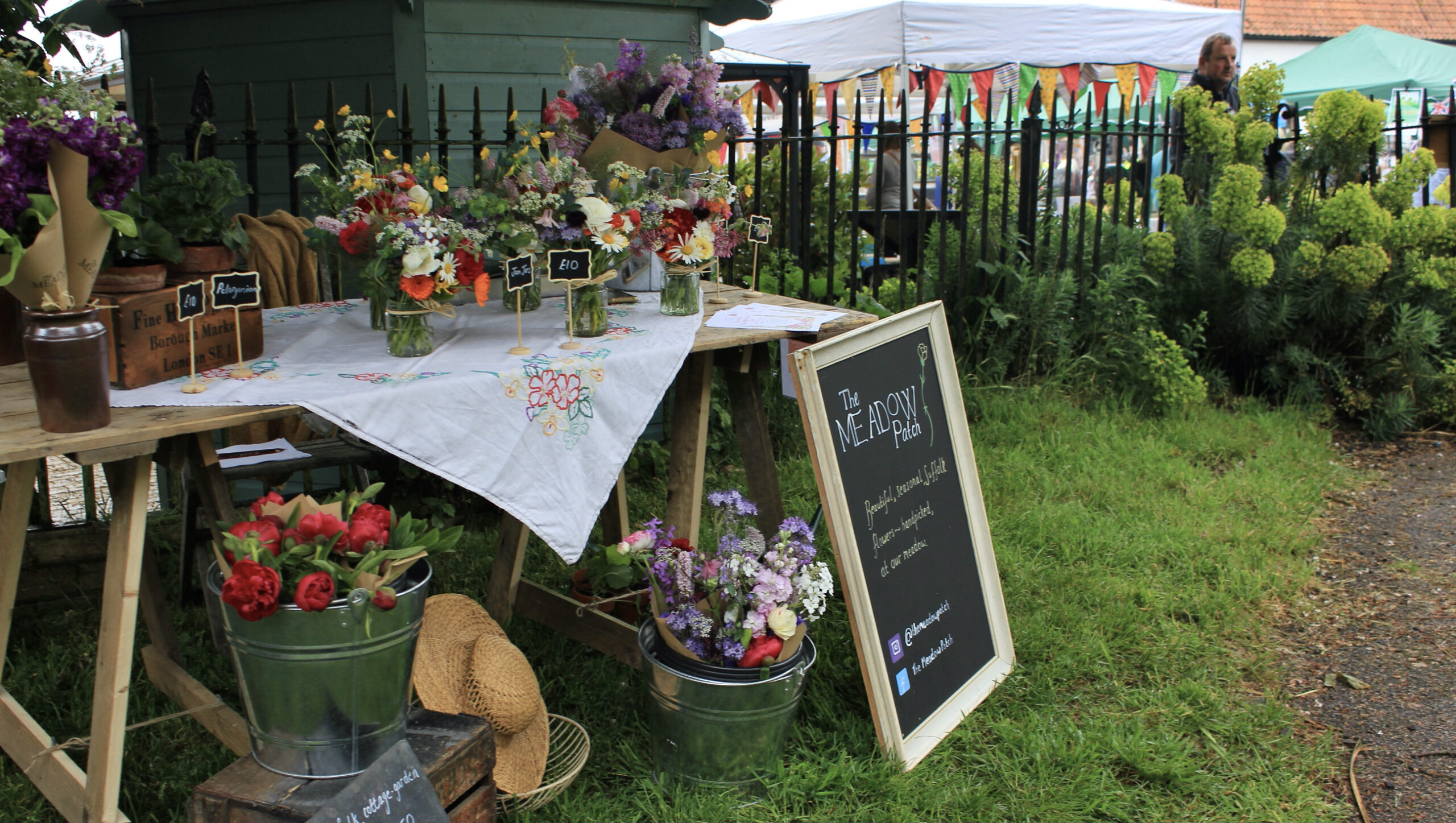 Locally grown flowers being sold at market by The Meadow Patch
