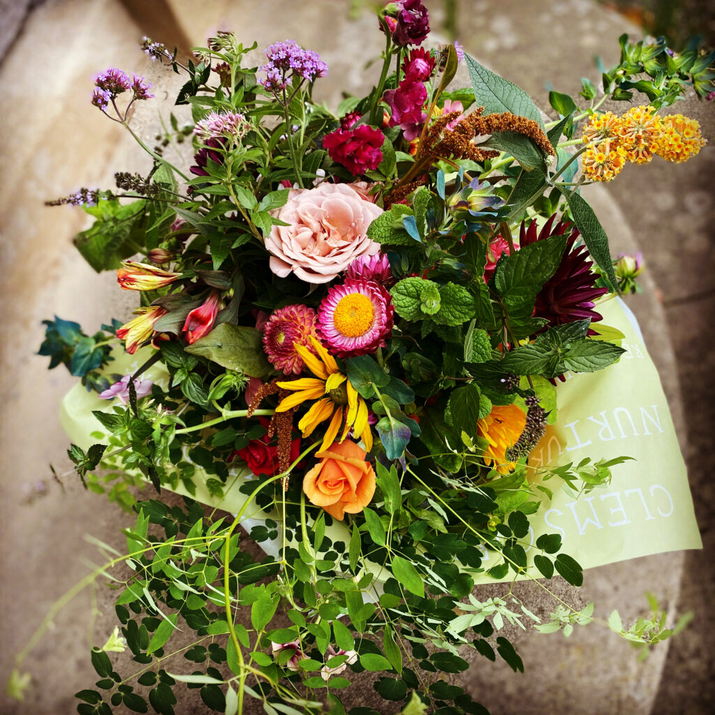 A locally grown gift bouquet featuring roses, herbs and foliage by Clem's Garden