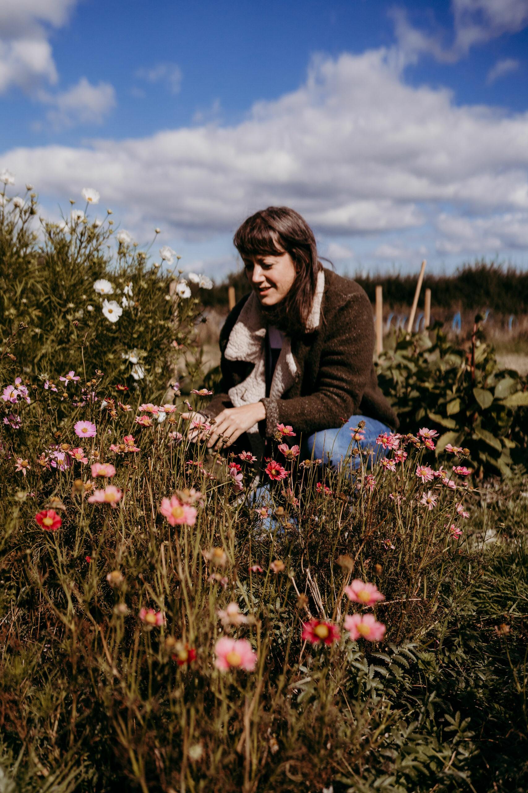 Lucy Marshall of Deadhead Flower Farm amongst the flowers on her plot