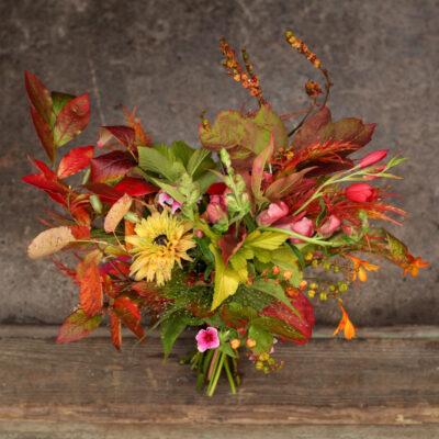 A fiery leafy woodland bride's bouquet for autumn wedding flowers