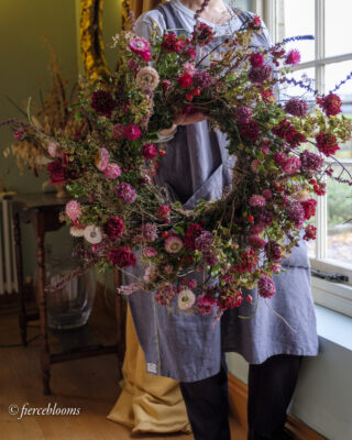 A wreath brimming with sustainable flowers, grown with the seasons using chemical free methods. Pink helichrysum do cartwheels in this glorious wild creation by Fierceblooms, Cheshire.