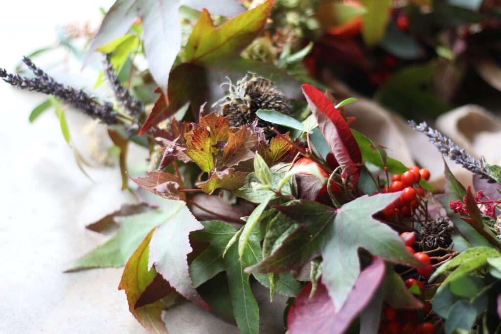 A leafy autumn wreath by Camomile and Cornflowers shows all the colours of the season.