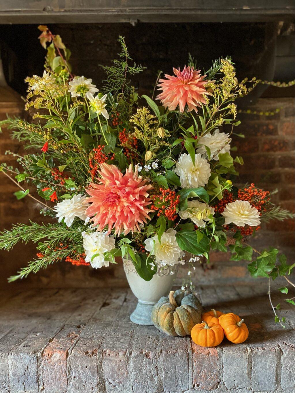 An autumn vase arrangement with mini pumpkins
