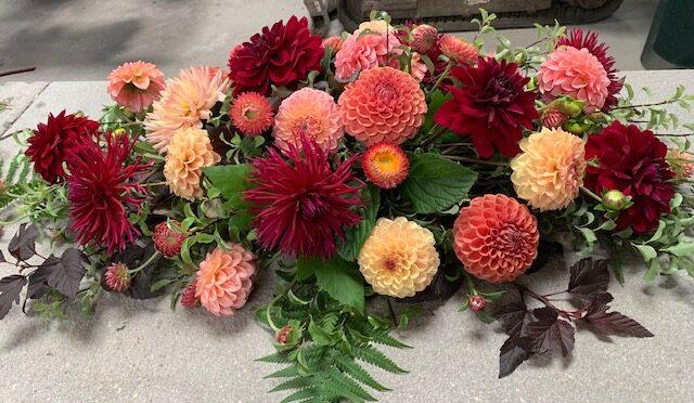 A memorial arrangement in autumnal colours